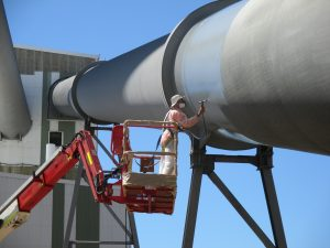 Grant Painters spraying at Mackay Harbour with industrial painting equipment